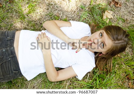 Girl lying and show silent symbol - stock photo