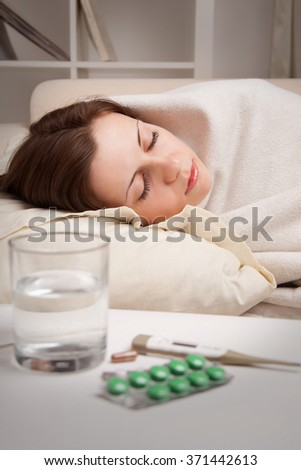 girl lying near sick medicines - stock photo