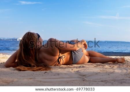 girl lying on a beach - stock photo
