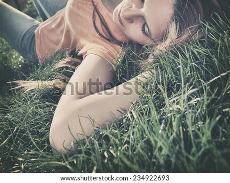 Girl lying on the grass - stock photo