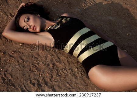 girl lying on the ground - stock photo