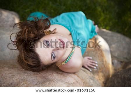 girl lying on the rocks - stock photo