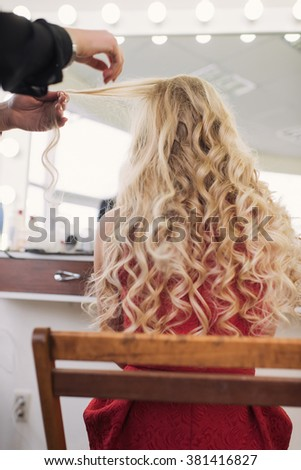 girl make curly hair - stock photo