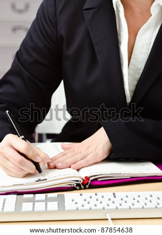girl make notice in a timer - stock photo