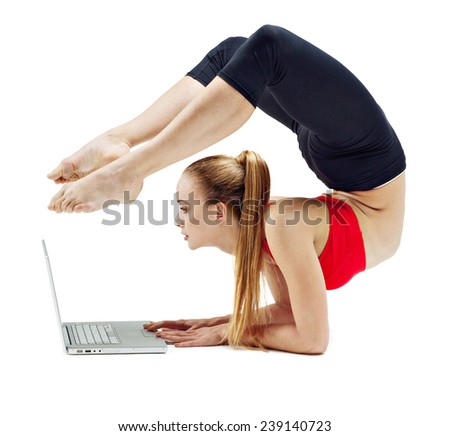 Girl makes exercise online with laptop - stock photo