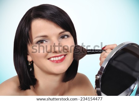 girl makeup applied with a brush on face - stock photo