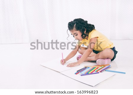 Girl making a drawing - stock photo