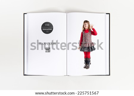 Girl making Ok sign printed on book - stock photo