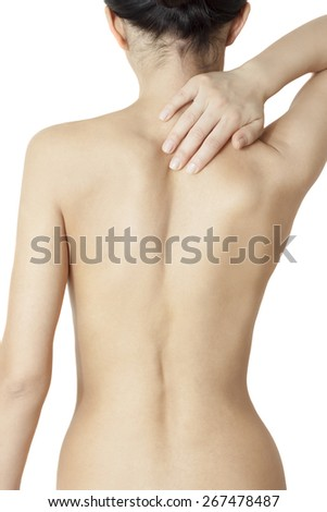 girl massaging sore neck and back - stock photo