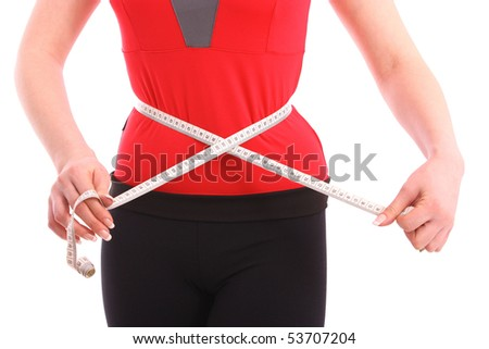 Girl measures her body on a white background. Healthy lifestyles concept. - stock photo