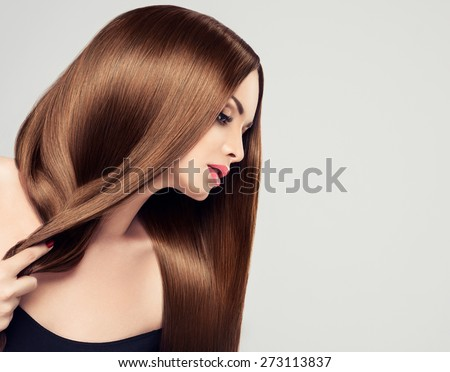 Girl model beauty with shiny long brown straight hair - stock photo