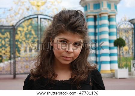 Girl near park golden gates - stock photo