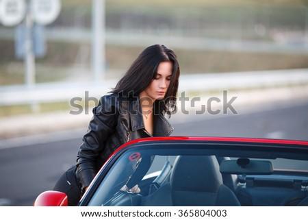 girl near red car - stock photo