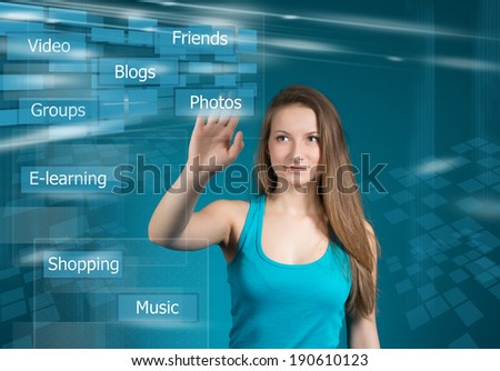 Girl near visual screen with social network and connected words - stock photo