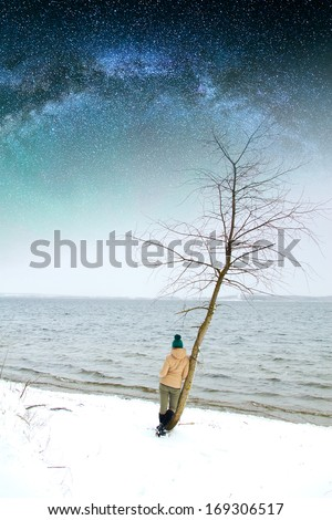 girl near winter river. Elements of this image furnished by NASA - stock photo