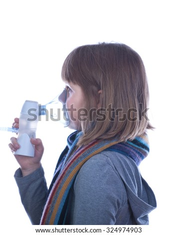 Girl nebulizer treatment isolated white - stock photo