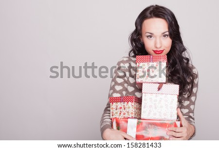 girl New Year's with gifts - stock photo