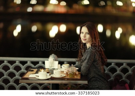 girl, night, dinner at an outdoor cafe - stock photo