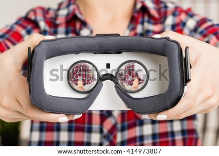 Girl offers to wear glasses virtual reality, VR goggles, VR-headset glasses - stock photo