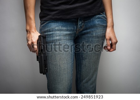Girl Officer Concealing Weapon - stock photo