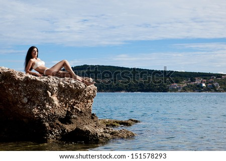 Girl on a beach in the summer - stock photo