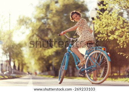 girl on a bicycle spring morning - stock photo