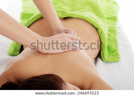 Girl on a stone therapy, hot stone massage. - stock photo