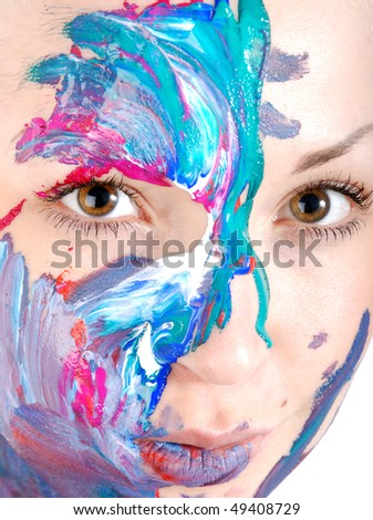 Girl on a white background decorated with paint. - stock photo