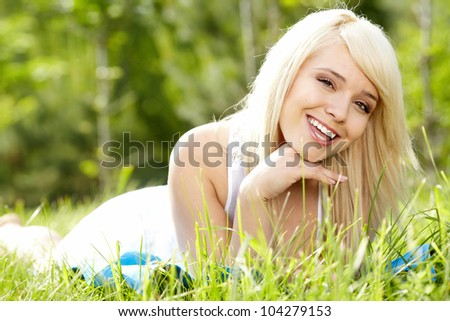 girl on green field - stock photo