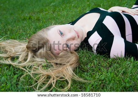 girl on green grass - stock photo
