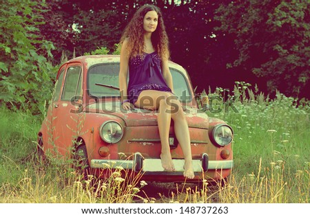 girl on old car - stock photo