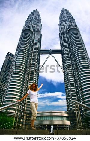 Girl on Petronas towers background - stock photo