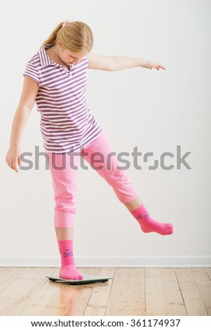 girl  on scales indoor - stock photo