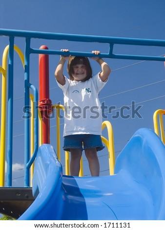girl on slide - stock photo