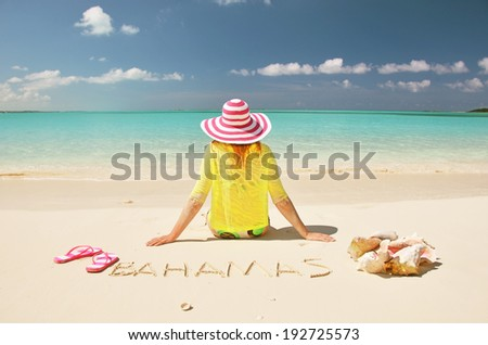 Girl on the beach. Great Exuma, Bahamas  - stock photo