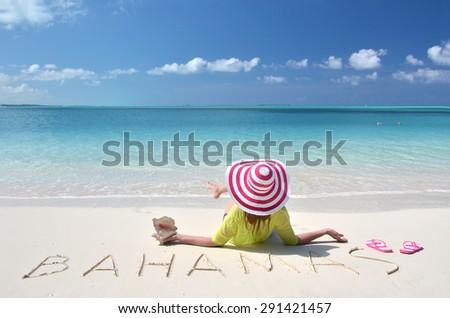 Girl on the beach. Great Exuma, Bahamas  - stock photo