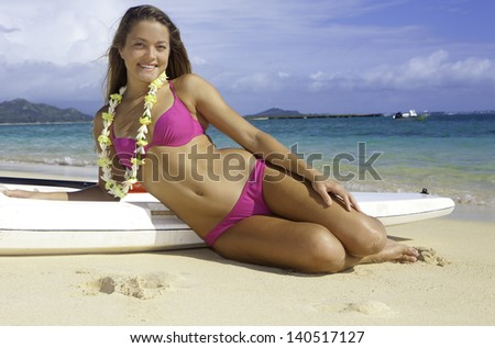girl on the beach in Hawaii with her surf ski - stock photo