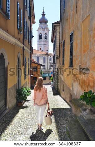Girl on the cobbled street of Menaggio town. Lake Como, Italy - stock photo