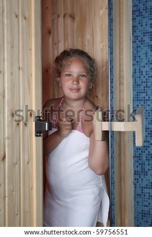 girl on the door of sauna - stock photo