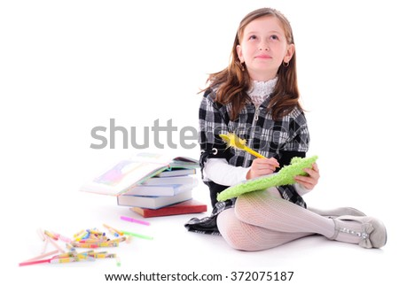 Girl on the floor is dreaming and writing in the diary - stock photo