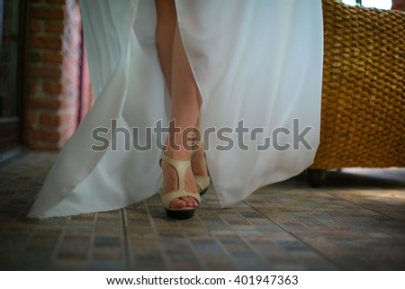 Girl on the heels and in the white dress - stock photo