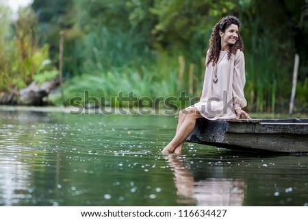 Girl on the lake - stock photo