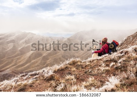 Girl on the nature beholds beautiful scenery - stock photo