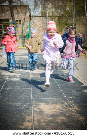girl on the playground. Girls Riding On See Saw In Playground. children play in kindergarten  - stock photo