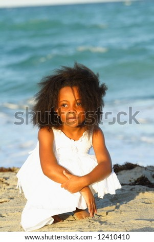 Girl on the sand - stock photo