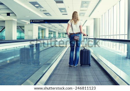 Girl on the speedwalk - stock photo