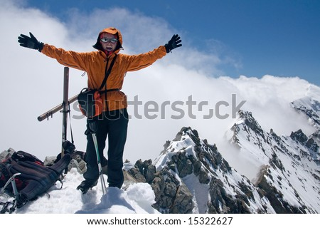 Girl on the top of peak - stock photo