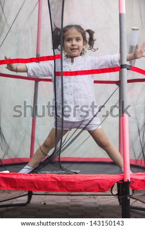 Girl on the trampoline - stock photo