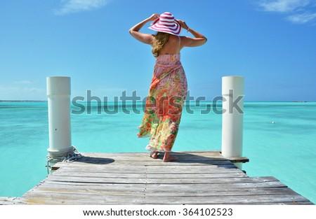 Girl on the wooden jetty. Exuma, Bahamas - stock photo
