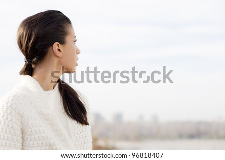 Girl on top of the city looking at panorama - stock photo